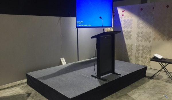 stage, projector, screen & lectern at symposium