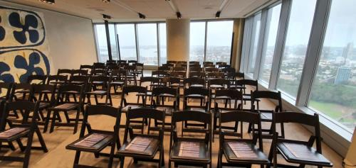Setting up for corporate seminar Sydney CBD with a pair of Bose L1 columns placed discreetly  at the back.