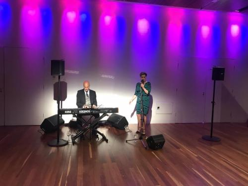 Gartner, Corporate event at the MCA, Sydney.   Bose S1 speakers, Sennheiser wireless mic, Gravity flat base speaker stands.  The keyboardist brough his own monitors.   Wireless links to all 3 Bose S1's.