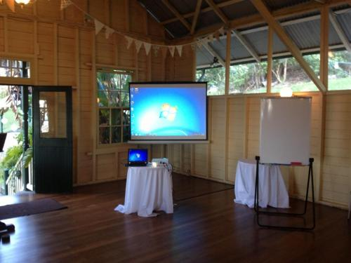 1.8m screen, 2600 lumen projector.   Wedding at Athol Hall, Mosman.