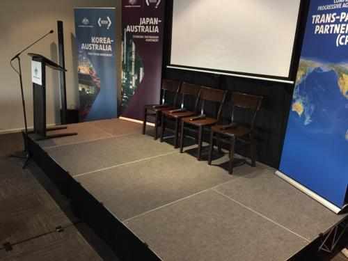 Austrade panel discussion. 4m x 3m stage, lectern mic, lectern, Bose L1 Compact speakers, Mackie DL1608 mixer.